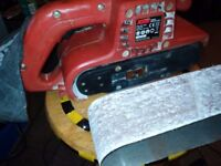 Heavy duty..... belt sander with dust bag and sanding belts