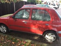 Red Nissan micra has been standing for a long time. It's a fixer upper, can be used for spare parts