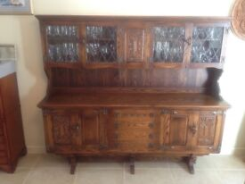 Solid oak dresser 6ft wide glass fronted top.