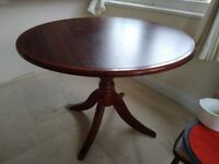 Circular mahogany dining table