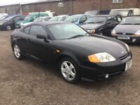 52REG HYUNDAI COUPE S IN LOVELY BLACK FSHISTORY LOW MILES IN VGCINDITION 1 YRS MOT SPORTS INTERIOR