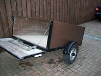 Trailer 5' X 4', drop down tail board, lockable spare wheel box with spare wheel.
