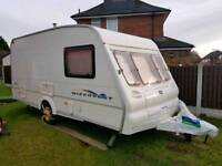 4/5 BERTH CARAVAN BAILEY DISCOVERY WITCH FULL SIZE AWNING AND FULL EQUIPMENT