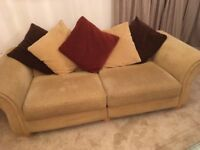 3 seater beige fabric sofa with large footstool