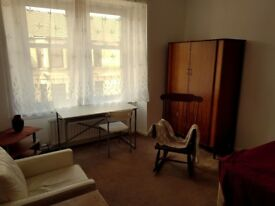 Fully furnished and sunny double bedroom in a quiet and safe area.