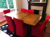 Heavy heavy walnut wood table and 6 chairs ( MINT MINT CONDITION )