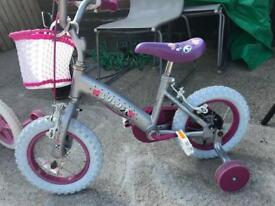 Two little girls bikes
