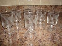 Six stemmed glasses