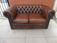 A Brown Leather Chesterfield Two Seater Sofa