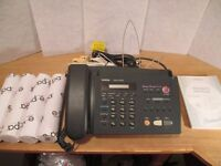 Brother Fax Machine FAX-520DT including owners manual and 4 fax rolls
