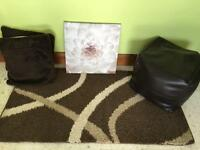 Browns and cream rug, pouffe , canvas cushions