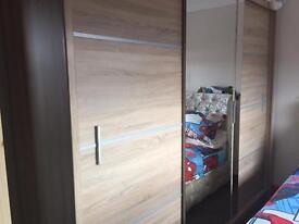 Three doored mirrored oak wood wardrobe