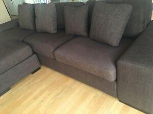Brown L shaped sofa