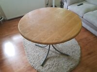 ROUND WOODEN DINING ROOM TABLE