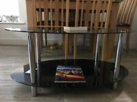Black Coffee table made up of glass