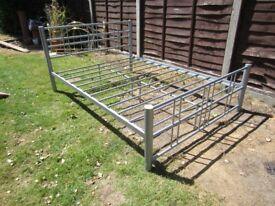 Double bed frame in silver metal tubing, strong and in excellent condition - no mattress