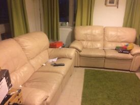 2 x cream leather recliner sofas