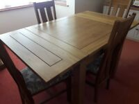 Solid oak extending table with 6 chairs. Excellent condition nearly new