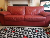 Two red leather sofa.