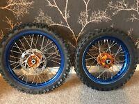 Ktm sx 50 big wheels blue wheel with orange hubs.