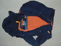 Superdry black windcheater jacket size M with orange lining - very good condition
