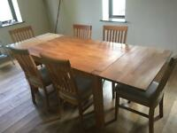 Oak Dining Table with Two Extension Leaves and Six Dining Chairs