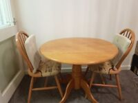 Pine Extendable Round Dining Table With Two Chairs