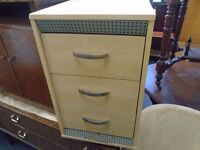 small pine look bedside cabinet.