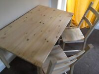 Solid pine dinning table and 2 pine chairs = £30