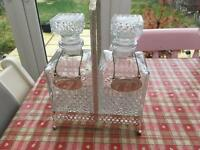 A pair of cut glass carafe