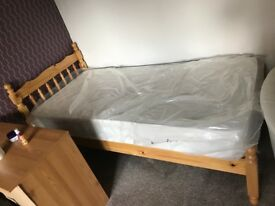 Single Bed frame and firm Mattress (almost New)