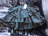 Girls green and flower pattern frilly skirt from Tammy age 11-12