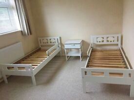 Two Ikea KRITTER Children Bed Frames with a Bedside Table