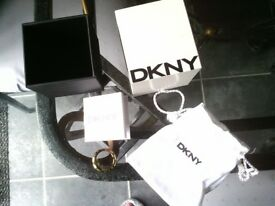 stunning new, never worn DKNY ring...beautiful design..small stones going round.paid £120.asking £35