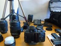 a DSLR 3100 camera and extras