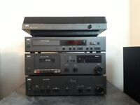 NAD Stereo system with Amp, CD deck, Turntable, Cassette deck and two Wharfendale speakers.