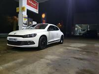 White VW Scirocco in perfect condition. Comes with warranty