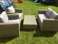 Stunning rattan set. 2 seater sofa, 2 chairs and table