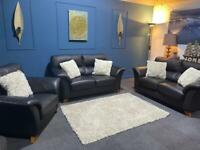 Black bonded leather suite 2 x 2 seater sofas and chair