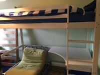 Wooden high sleeper bed with desk.
