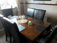 Large heavy wood dining table and chairs