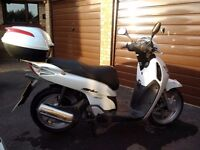 Honda Shi 125 motorbike with top box and heated handle grips