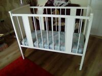 Mothercare White wooden baby cot complete with a mattress