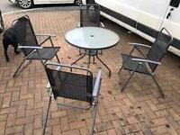 Patio Glass Top Table & folding chairs. Can deliver