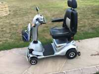Quingo plus 8MPH mobility scooter in showroom condition