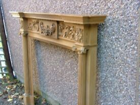 Ornate carved pine fire surround by Hallidays of London