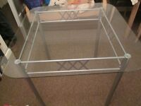 Excellent condition glass table and four chairs