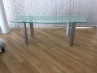 Glass coffee table in excellent condition, metal legs. Rectangular design. £30. Pick up only