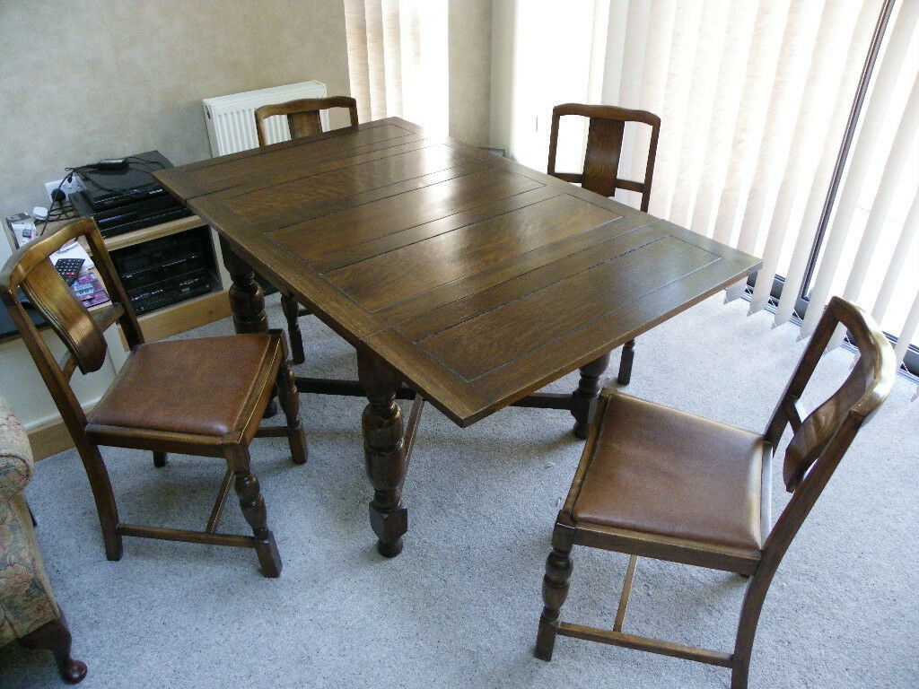 Mid 20th century dining room table with extending leaves and 4 matching chairs