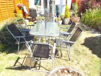 Glass garden table 6 chairs and umbrilla